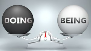 Doing and being in balance - pictured as a scale and words Doing, being - to symbolize desired harmony between Doing and being in life, 3d illustration