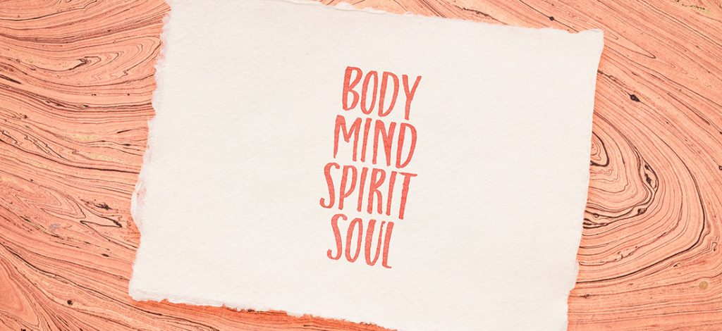 body, mind, soul, spirit - personal growth or development concept - handwriting on a handmade paper